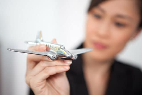a woman with a toy airplane