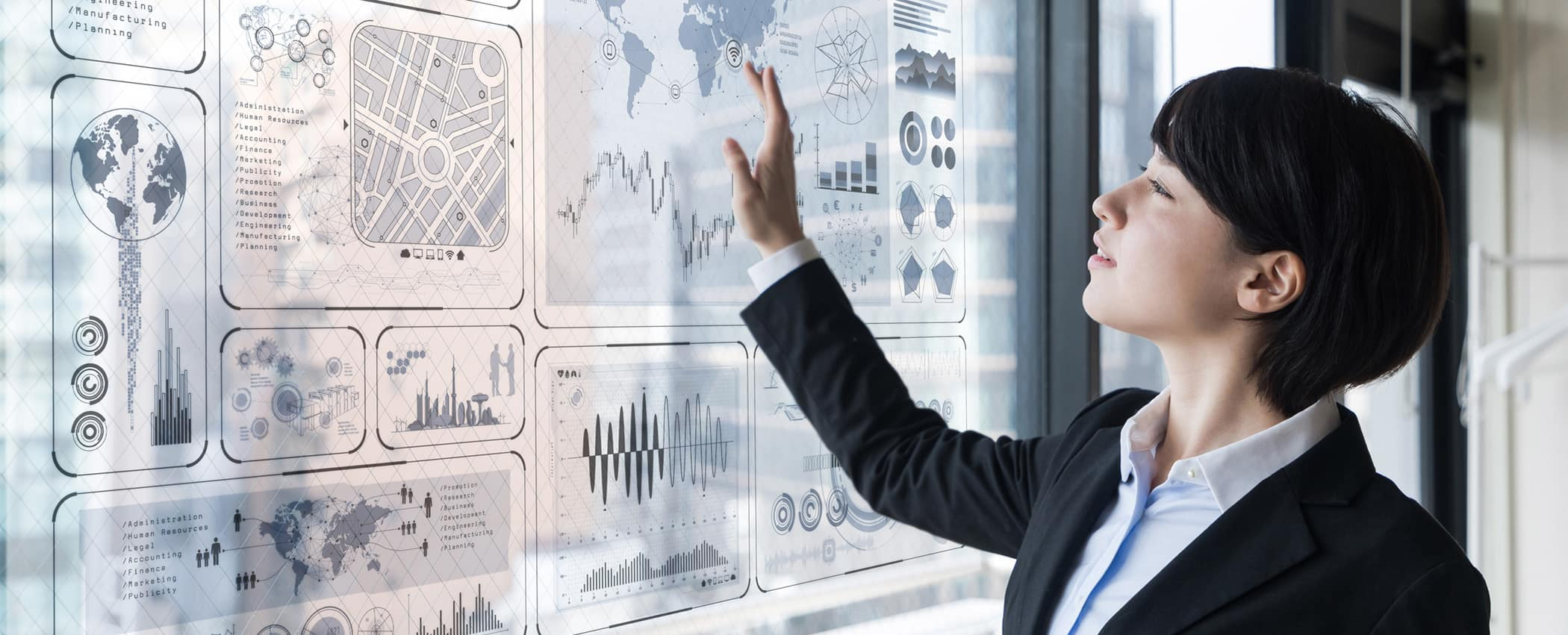 Woman looks at a board with data.